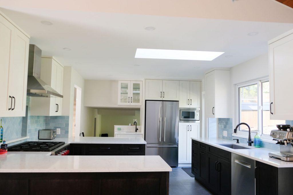 Two-tone kitchen cabinets with Walker Zanger backsplash tile